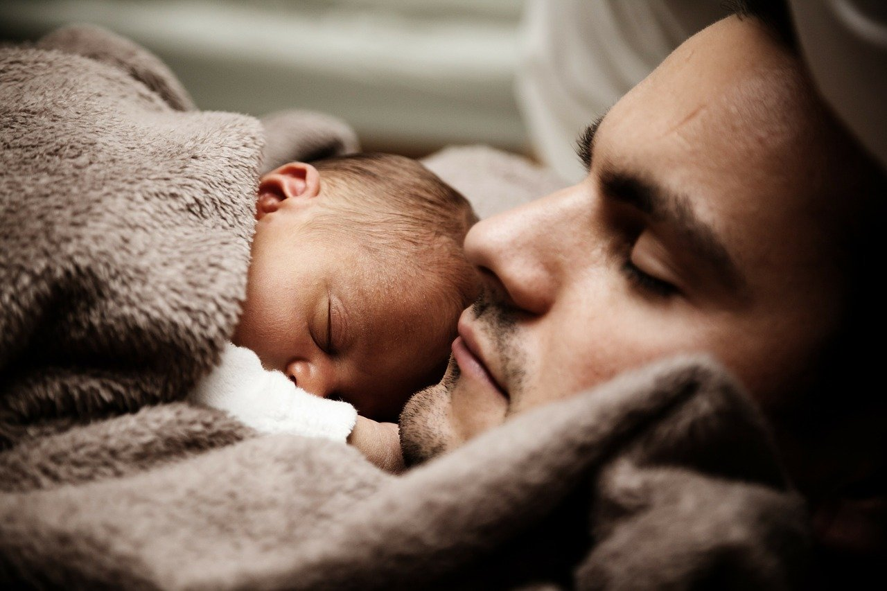 Baby and father alseep