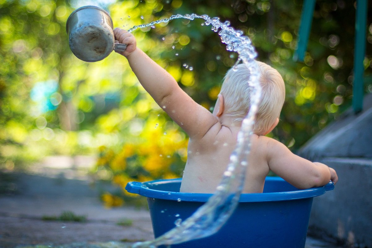 Baby playing in water